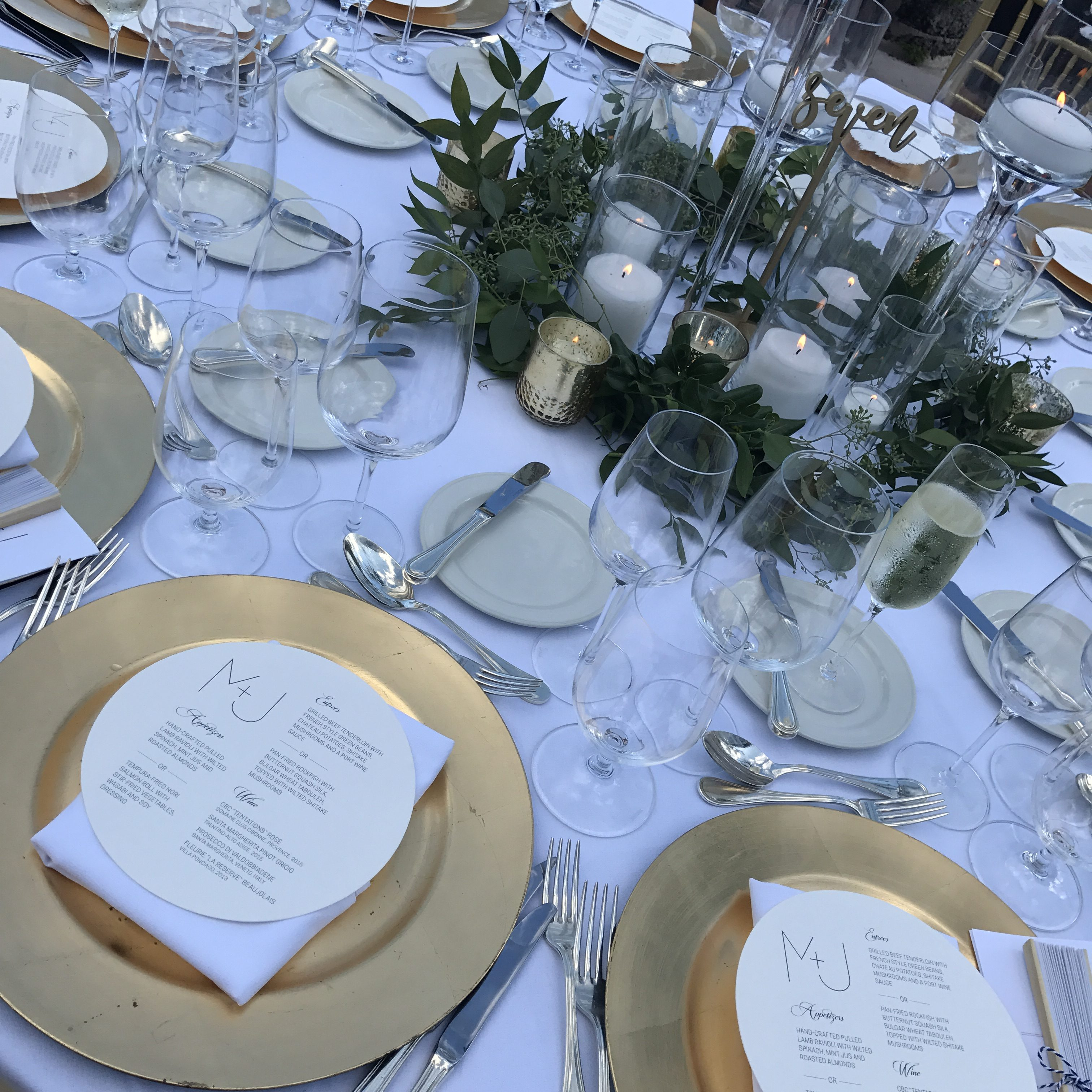 Close up detail of the wedding reception tables with printed menus.